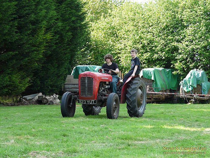 Brothers enjoying the tractor